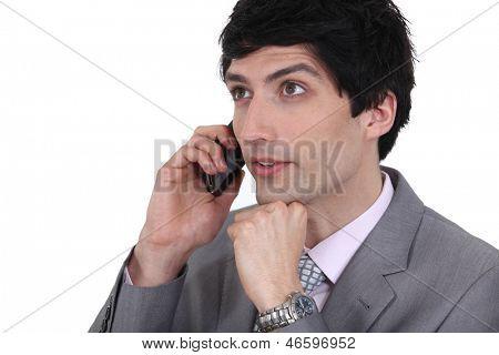 dishy businessman on phone with dreamy eyes