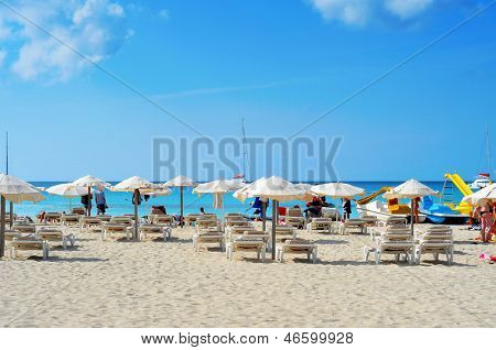 FORMENTERA, SPAIN - SEPTEMBER 19: Bathers in Ses Illetes Beach on September 19, 2012 in Formentera, Balearic Islands, Spain. Formentera is renowned across Europe for many white beaches like this