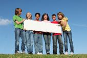 group of diverse kidschildren holding blank sign banner or poster poster