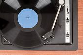 Spinning vinyl record. Motion blur image. Vintage toned. Shallow depth of field. poster