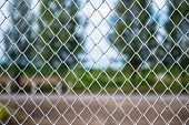 Metallic Wire Chain Link Fence at the farmland poster