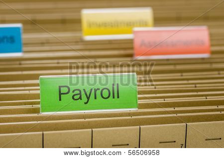 A hanging file folder labeled with Payroll