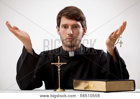 Young Reverend With Rosary And The Bible