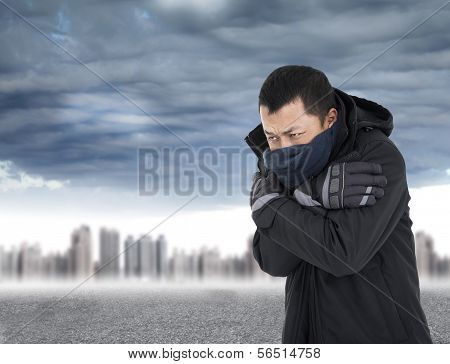 Young Man Tightening Body In Outdoors Cold Weather