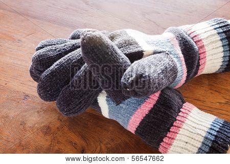 Human Hands Wear Wool Gloves