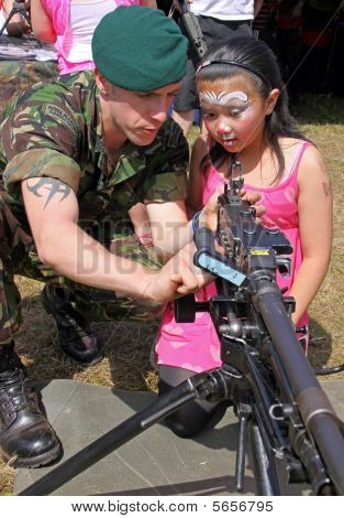 A British Army solidier and girl at the Bristol Balloon Fiesta, UK 8/8/09
