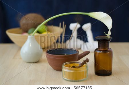 A table top arrangement of spice oil and massaging tools used in Ayurveda massage. poster