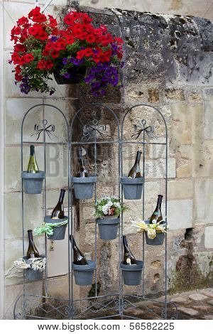 Bottles of wine in flowerpots - most beautiful French flowers