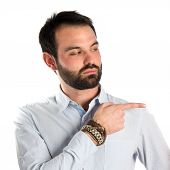 Men pointing somebody over isolated white background poster