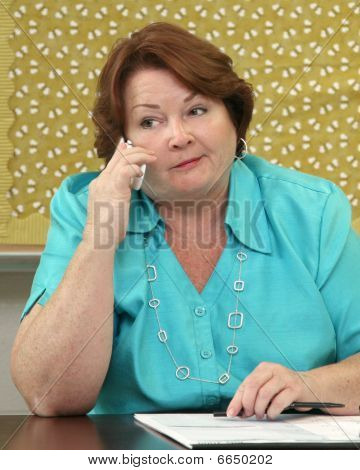 Business Woman On The Phone At Her Desk