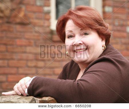 Portrait Of An Older Woman In The Sunlight