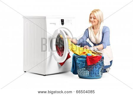 Woman emptying a washing machine isolated on white background poster