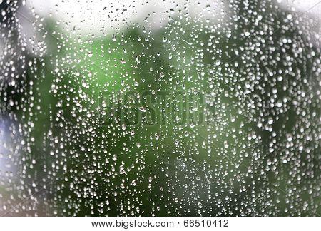 Rain water drops on window glass
