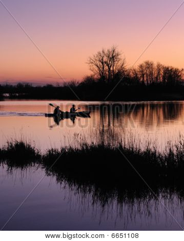 Two kayakers at dawn