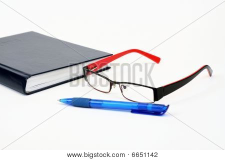 Calendar With Pen And Eyeglasses