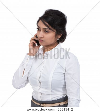 Sad businesswoman talking on mobile phone