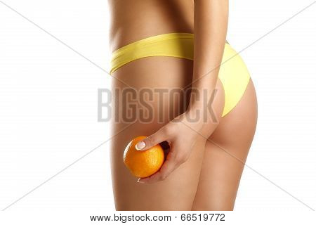 Close Up Of A Woman Showing Hips With A Fruit In Her Hand