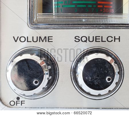 Knobs that control volume and squelch on a cb radio poster