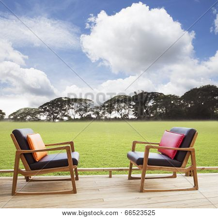 Relax Chairs On Wood Terrace With Grass Field And Beautiful Sky Use As Natural Background,backdrop