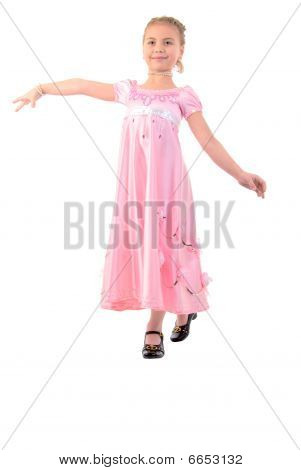 Little Girl Looks Like A Small Princess In Beautiful Pink Dress. Studio Shoot Over White Background.