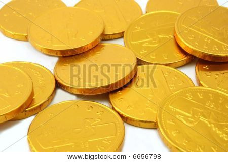 Chocolate gold coins, scattered