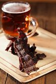 jerky beef with beer - homemade dried cured spiced meat poster