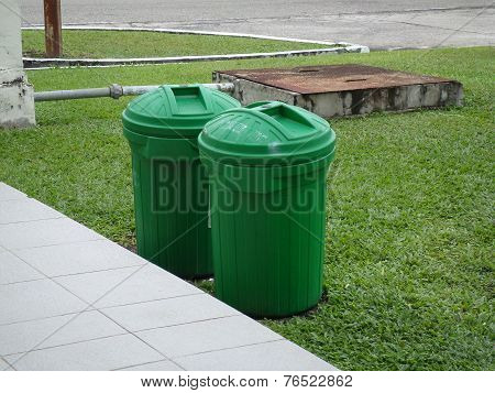 Trash cans and underground septic tank