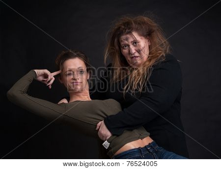 Drunk Two Women Over Black Background