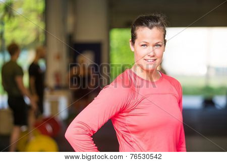Portrait of confident young woman standing at healthclub