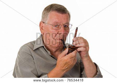 Old Man Tamping Pipe