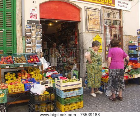Ladies outside busy green grocers
