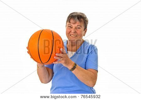 Senior Woman Playing Basketball