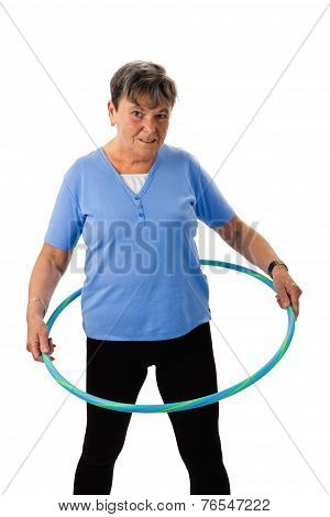 Senior Woman Exercising With Hula-hoop