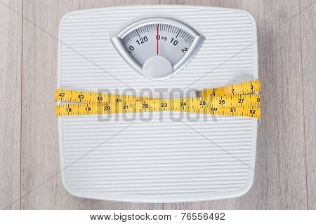 Weight Scale Wrapped In Measure Tape