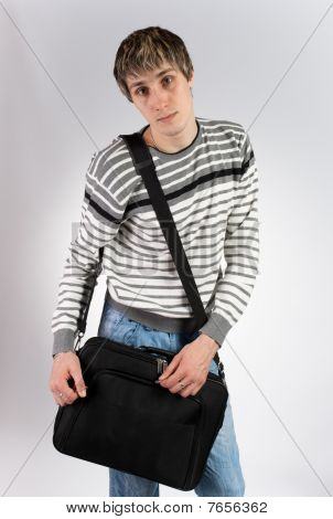 A Young Man With A Computer Bag
