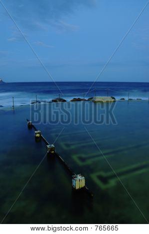 Seaside ocean pool at sunset