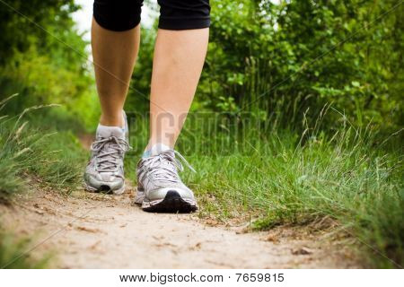 Woman Walking Cross Country And Trail