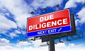 Due Diligence - Red Billboard on Sky Background. Business Concept. poster