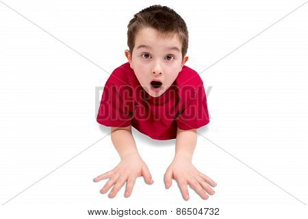 Surprised Cute Male Kid Lying On His Stomach
