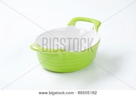 green casserole dish on white background