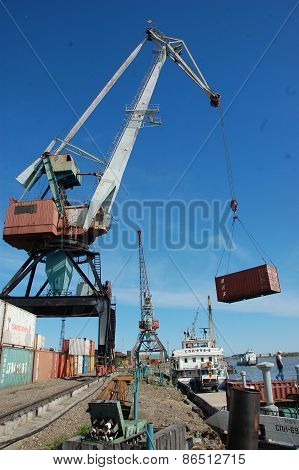 Dockside Cargo Crane With Container At River Port