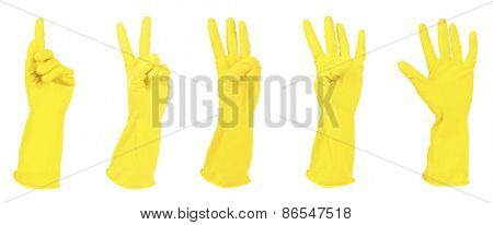 Yellow gloves gesturing numbers isolated on white