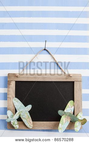 Rustic chalkboard in striped painted wooden board with paper planes poster
