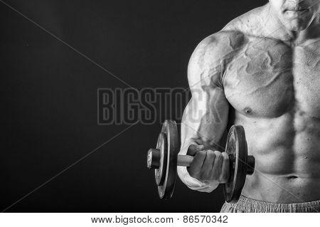 Man makes exercises dumbbells.