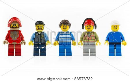 A Group Of Five Various Lego Mini Characters Isolated On White.