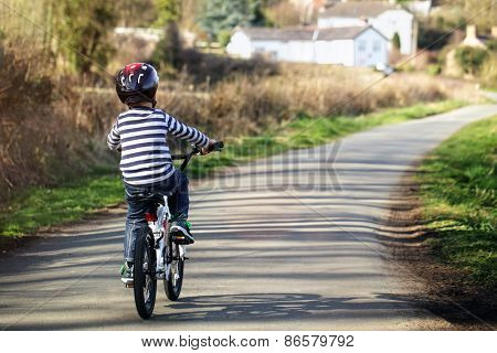 Riding a bicycle on a country road concept for healthy lifestyle, exercising and road safety
