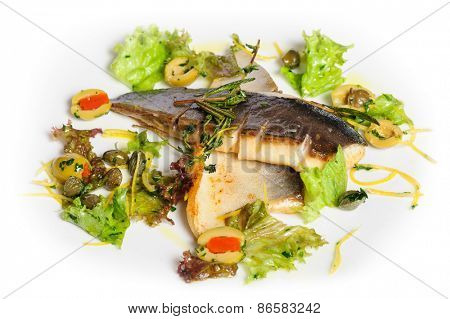 Pompano or dorada fish fillet fried and served with herbs