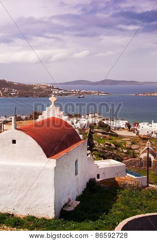Church And Top View Of The Town Of Mykonos And Windmills, The Sea. View Of Mykonos Town With The Hei