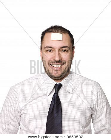 Man with note on his forehead