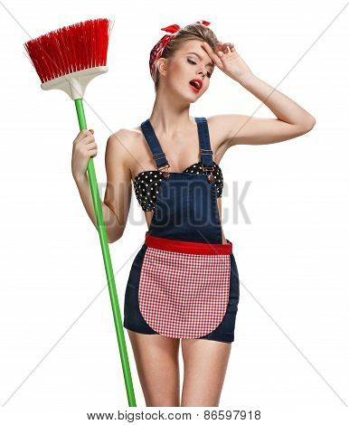 Tired Maid Standing After Spring Cleaning With Broom / Young Beautiful American Pin-up Girl Isolated
